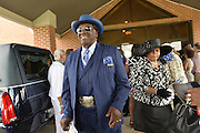 "5/30/15 Indianola  Harmonica player  Big George Brock arrives to see his friend B B King's funeral service.  ""See That My Grave Is Kept Clean"" one of BB Kings famous songs forecast his funeral procession complete with two white horses and a black horse flanked with two signed Gibson guitars. Fans lined the street to see B.B. Kings final homecoming and pay their respect. Photo ©Suzi Altman"