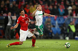 Switzerland's Fabian Schar (left) and Northern Ireland's Jamie Ward battle for the ball during the FIFA World Cup Qualifying second leg match at St Jakob Park, Basel.