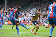 Wilfried Zaha of Crystal Palace takes a shot at goal. Barclays Premier league match, Crystal Palace v Arsenal at  Selhurst Park in London on Sunday 16th August 2015.<br /> pic by John Patrick Fletcher, Andrew Orchard sports photography.