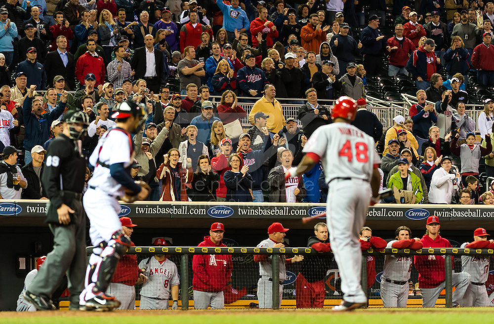 Minnesota Twins fans celebrate after Los Angeles Angels right fielder Torii Hunter strikes out to end the game on May 8, 2012 at Target Field in Minneapolis, Minnesota.  The Twins defeated the Angels 5 to 0. © 2012 Ben Krause