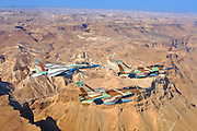 A formation of 2 F16 and one F15 Israeli Air Force fighter jets flying over Masada Dead sea area
