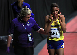 Sweden's Meraf Bahta is assessed by medical staff after falling in the Women's 1500m Heat 2 during day two of the 2018 IAAF Indoor World Championships at The Arena Birmingham.