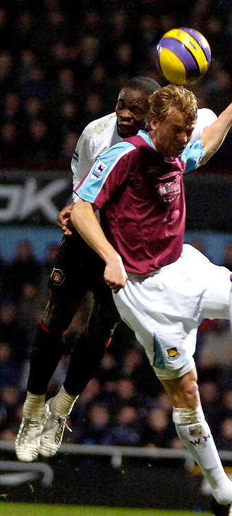 Photo: Ed Godden.<br /> West Ham United v Manchester United. The Barclays Premiership. 17/12/2006. Man Utd's Louis Saha (L) and Jonathan Spector colide in the air.