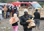 Queue for food at 'the Jungle' migrant camp in Calais, France, August 10, 2015. The Calais jungle is the nickname given to a series of camps in the vicinity of Calais, France, where migrants live while they attempt to enter the United Kingdom illegally by stowing away on lorries, ferries, cars, or trains travelling through the Port of Calais or the Eurotunnel Calais Terminal. The migrants are a mix of refugees, asylum seekers and economic migrants from Darfur, Afghanistan, Syria, Iraq, Eritrea and other troubled areas of the world.