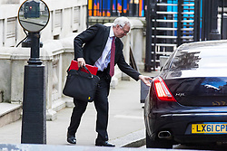 © Licensed to London News Pictures. 07/02/2018. London, UK.Secretary of State for Exiting the European Union David Davis leaves his office on Downing Street shortly before Prime Minister's Questions. Photo credit: Rob Pinney/LNP