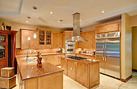 View of a modern kitchen with stainless steel appliances.