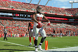 October 21, 2018 - Tampa, FL, U.S. - TAMPA, FL - OCT 21: O. J. Howard (80) of the Bucs gets up after making a first down and flexes his muscles for the fans during the regular season game between the Cleveland Browns and the Tampa Bay Buccaneers on October 21, 2018 at Raymond James Stadium in Tampa, Florida. (Photo by Cliff Welch/Icon Sportswire) (Credit Image: © Cliff Welch/Icon SMI via ZUMA Press)
