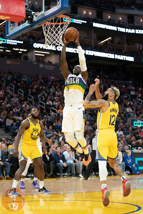 February 23, 2020; San Francisco, California, USA; New Orleans Pelicans guard Jrue Holiday (11) dunks the basketball during the fourth quarter against the Golden State Warriors at Chase Center.