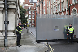 © Licensed to London News Pictures. 04/11/2015. London, UK.  A mobile police barrier is in place to protect Conservative party headquarters ahead of a student demonstration in central London over tuition fees and cuts. Photo credit: Peter Macdiarmid/LNP