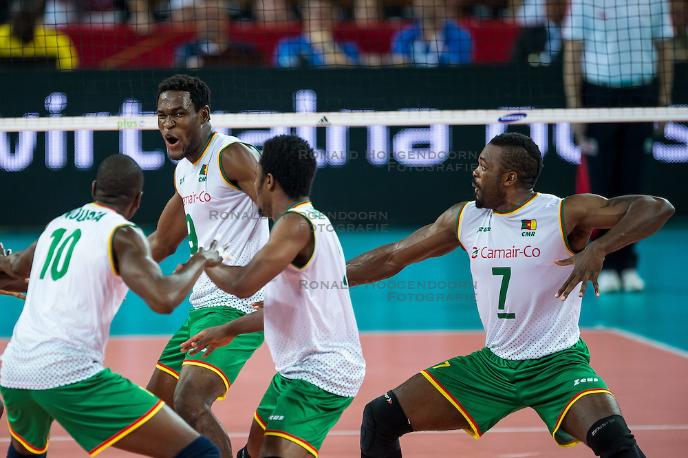 07.09.2014, Centennial Hall, Breslau, POL, FIVB WM, Serbien vs Kamerun, Gruppe A, im Bild Kamerun radosc taniec Maliki Moussa cameroon #10 Joseph Herve Kofane Boyomo cameroon #9 Jean Patrice Ndaki Mboulet cameroon #7 // Cameroon gladness dance Maliki Moussa cameroon #10 Joseph Herve Kofane Boyomo cameroon #9 Jean Patrice Ndaki Mboulet cameroon #7 // during the FIVB Volleyball Men's World Championships Pool A Match beween Serbia and Cameroon at the Centennial Hall in Breslau, Poland on 2014/09/07. <br /> <br /> ***NETHERLANDS ONLY***