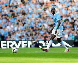 Manchester City's Yaya Toure - Photo mandatory by-line: Dougie Allward/JMP - Tel: Mobile: 07966 386802 22/09/2013 - SPORT - FOOTBALL - City of Manchester Stadium - Manchester - Manchester City V Manchester United - Barclays Premier League