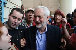 © Licensed to London News Pictures. 19/08/2016. Sheffield, UK. Jeremy Corbyn is surrounded by supporters after speaking at a campaign rally in Sheffield, South Yorkshire, during the 2016 Labour leadership election. Photo credit : Ian Hinchliffe/LNP