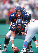 Aug 29,1998; Nashville, Tennessee, USA; Quarterback John Elway, and Center, Tom Nalen of the Denver Broncos in action against the Tennessee Oilers at Vanderbilt Stadium.  The Broncos lost the preseason game to the Oilers 16-13.