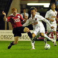 Photo: Dave Linney.<br />Walsall FC v Manchester United XI. Pre Season Friendly. 18/07/2006Walsall' .Daniel Fox (R) keepsMichael Barnes at bay