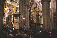 In the cathedral at Santiago de Compostela, congregants watch the famous swinging of the botafumerio. (July 13, 2018)<br />