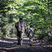 """Brett Ladeau, of Hartland, left, walks with his daughter Sydney Ladeau, 10, in New Hampshire during youth turkey opener on April 28, 2012.  Sydney said, """"I actually sort of like getting up early.  I'm excited, and I can't wait for the hunt. And I get to spend time with my dad."""""""