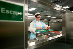 Crew in the galley prepare the first meals ahead of sea trials this summer, for the Royal Navy's new aircraft carrier HMS Queen Elizabeth, at Rosyth Dockyard in Dunfermline.