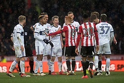 Brentford and Middlesbrough players clash after Brentford's Romaine Sawyers foul which leads to his second yellow card