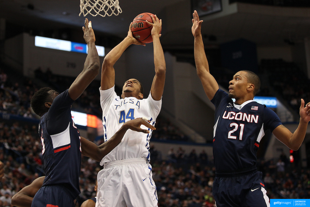 Brandon Swannegan, (center) Tulsa, shoots while challenged by Daniel Hamilton, (left) and Omar Calhoun, UConn, during the UConn Huskies Vs Tulsa Semi Final game at the American Athletic Conference Men's College Basketball Championships 2015 at the XL Center, Hartford, Connecticut, USA. 14th March 2015. Photo Tim Clayton