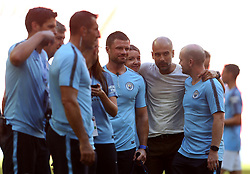 Manchester City manager Josep Guardiola with his staff at full time