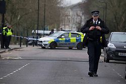 © Licensed to London News Pictures.10/12/2020. London, UK. A cordon remains in a place as police continue to investigate after pupils and staff at Stoke Newington School in north London have been evacuated after revived a bomb threat around 11:55am.  Photo credit: Marcin Nowak/LNPPhoto credit: Marcin Nowak/LNP