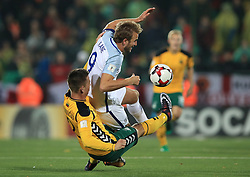 England's Harry Kane is challenged by Lithuania's Linas Klimavicius during the 2018 FIFA World Cup Qualifying Group F match at the LFF Stadium, Vilnius.