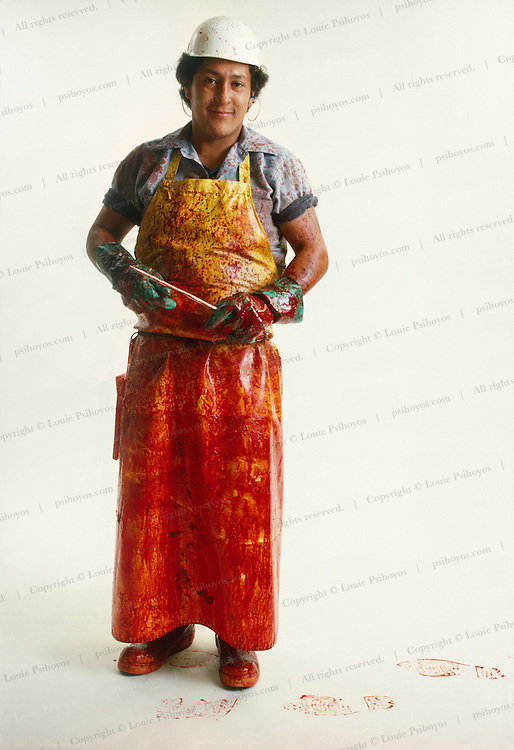 A Hitch Enterprises slaughterhouse worker with soiled apron and white background.