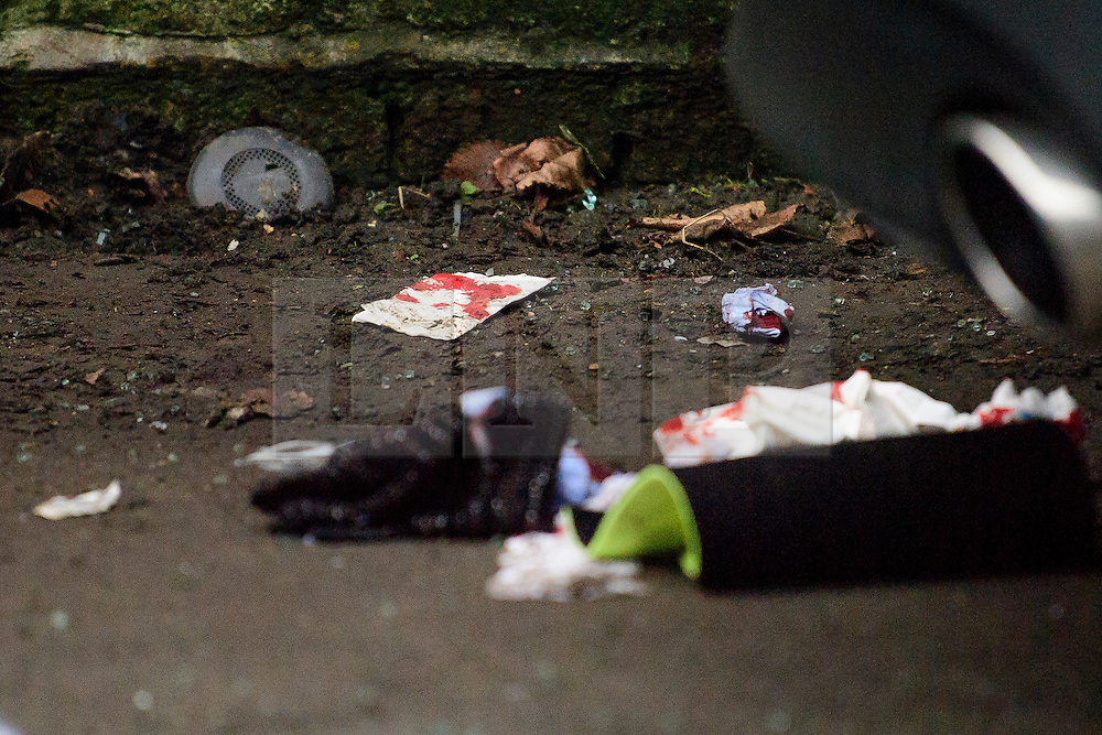 © Licensed to London News Pictures. 12/12/2016. London, UK. Bloodied materials on the ground where a person was thrown over the railing of a bridge when a Ferrari sports car ploughed in to a group of pedestrians in Battersea, South London. Photo credit: Ben Cawthra/LNP