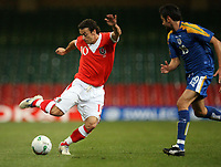 Photo: Rich Eaton.<br /> <br /> Wales v Cyprus. UEFA European Championships 2008 Qualifying. 11/10/2006. Simon Davies of Wales turns on the  style against Alexandros Garpozis #19