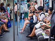 26 JULY 2013 - BANGKOK, THAILAND:  Passengers on the BTS Skytrain in Bangkok, Thailand.       PHOTO BY JACK KURTZ