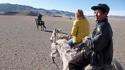 Riding on horseback to the Eagle Hunting festival near Sagsai, Bayan-Ölgii, Mongolia
