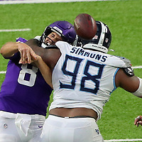 MINNEAPOLIS, MN - SEPTEMBER 27: Kirk Cousins #8 of the Minnesota Vikings gets hit by Jeffery Simmons #98 of the Tennessee Titans in the fourth quarter at U.S. Bank Stadium on September 27, 2020 in Minneapolis, Minnesota. The Tennessee Titans defeated the Minnesota Vikings 31-30.(Photo by Adam Bettcher/Getty Images) *** Local Caption *** Kirk Cousins; Jeffery Simmons
