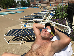Joe Vogt of Webster Groves watches the partial phase of the solar eclipse at the Webster Groves Aquatic Center on Monday, Aug. 21, 2017. Photo by Hillary Levin/St. Louis Post-Dispatch/TNS/ABACAPRESS.COM