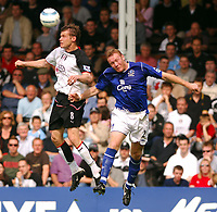 Photo: Daniel Hambury, Digitalsport<br /> Fulham v Everton.<br /> FA Barclays Premiership.<br /> 30/04/2005.<br /> Fulham's second goal scorer Brian McBride and Everton's Steve Watson battle for the ball.