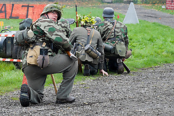 Re-enactors portrayiing a German panzergrenadiers from the Grossdeutschland Diviision during a battle battle re-enactment in on Pickering Showground<br /> <br /> 17/18 October 2015<br />  Image © Paul David Drabble <br />  www.pauldaviddrabble.co.uk