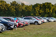12 SEPTEMBER 2020 - DES MOINES, IOWA: Cars parked in Waterworks Park during the Polk County Democrats Steak Fry at the park in Des Moines. The Steak Fry is the largest fundraiser of the year for Polk County Democrats. This year nearly 1,000 people attended. The Steak Fry observed public health guidelines. Normally the Steak Fry is a picnic but this year people stayed in their cars while meals were brought to them and they wore masks when they were outside of the cars. Most of the speakers appeared via online speeches.    PHOTO BY JACK KURTZ