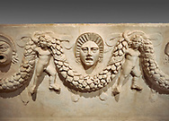 """Close up picture of Roman relief sculpted Sarcophagus of Garlands, 2nd century AD, Perge. This type of sarcophagus is described as a """"Pamphylia Type Sarcophagus"""". It is known that these sarcophagi garlanded tombs originated in Perge and manufactured in the sculptural workshops of Perge. Antalya Archaeology Museum, Turkey.. Against a grey background..<br /> <br /> If you prefer to buy from our ALAMY STOCK LIBRARY page at https://www.alamy.com/portfolio/paul-williams-funkystock/greco-roman-sculptures.html . Type -    Antalya    - into LOWER SEARCH WITHIN GALLERY box - Refine search by adding a subject, place, background colour, etc.<br /> <br /> Visit our ROMAN WORLD PHOTO COLLECTIONS for more photos to download or buy as wall art prints https://funkystock.photoshelter.com/gallery-collection/The-Romans-Art-Artefacts-Antiquities-Historic-Sites-Pictures-Images/C0000r2uLJJo9_s0"""