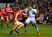 Sale Sharks wing Marland Yarde takes evasive action as   Saracens second-row Callum Hunter-Hill attempts a tackle during a Premiership Rugby Cup Semi Final  won by Sale 28-7, Friday, Feb. 7, 2020, in Eccles, United Kingdom. (Steve Flynn/Image of Sport)