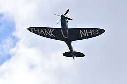 © Licensed to London News Pictures. 10/07/2020.  London UK: A Spitfire flies over the Nightingale Hospital in Newham, East London with Thank U NHS written on its underside, thanking the NHS during the Coronavirus pandemic , Photo credit: Steve Poston/LNP