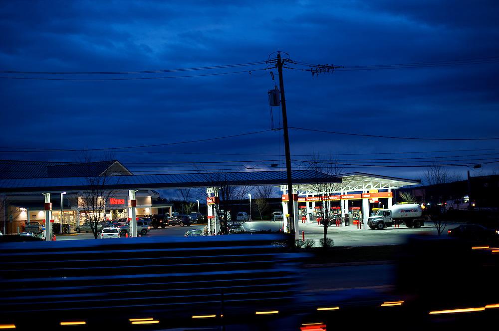An 18 wheeler blurs past the #205 Wawa store in Malvern, PA at dawn on January 31, 2013.