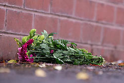 © Licensed to London News Pictures . 10/12/2013 . Bolton , UK . A single bunch of flowers left inside the police cordon , outside the house . The scene outside 123 Albert Road West in Bolton today (10th December 2013) where three people died following a fire , yesterday morning (9th December 2013) . Police believe the fire was started deliberatively by architect Hassan Rafie , killing himself and his wife Mahnaz . Another woman staying in the house at the time , believed to be Mrs Rafie's mother , later died of injuries sustained in the fire , in hospital . Photo credit : Joel Goodman/LNP