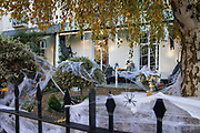 Cobwebs and other decorations are arranged around a garden to mark Halloween on 31 October 2020 in Windsor, United Kingdom. Halloween celebrations, and in particular the custom of trick-or-treating, will vary across the UK this year due to coronavirus restrictions which differ by Tier alert levels and the Prime Minister's official spokesman has urged people to apply common sense.