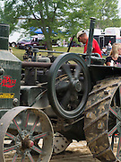 An antique Rumley, oil-pull steam tractor is on parade at the Rock River Thresheree, Edgerton, Wisconsin; 2 Sept 2013