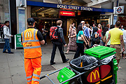 McDonalds litter patrol outside entrance to Bond Street underground station in central London