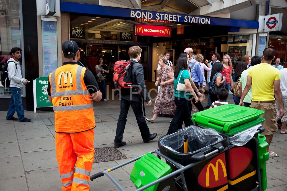 McDonalds litter patrol outside entrance to Bond Street underground station in central London