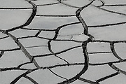 Cracked mud shows neat patterns as it dries - this is found at the Mud Volcano in the Hayden Valley, between Canyon Village & Fishing Bridge in Yellowstone National Park, Wyoming
