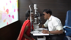 """EXCLUSIVE: Battling a rare health condition that has left half of her face disfigured, a 24-year-old Indian woman says she tries to live positively despite jeers by people. Sasikala K, from Chennai, the capital of India's southern Tamil Nadu state, suffers from plexiform neurofibromatosis, which has taken a toll on her face, affecting the right side. However, she admits her confidence has taken a hit of late. Sasikala, who prefers to live boldly and does not cover her face, likes dressing up and wearing make-up, much like girls her age, though she finds it difficult to execute them owing to her complications. She was only six-months-old when her parents noticed a part of her face swelling. However, they waited for another one and a half years to get medical help. """"I have always been very bold, however, with age, the condition progressed and no one has come for help,"""" she says, adding, """"I am slowly losing my confidence."""" According to medical experts, her condition affects the face and craniofacial region of the body. It can also affect the neck and other parts of the body, depending upon the host. The family had not considered the deformity to be a big issue until Sasikala turned six and the face started to swell at an unusual rate. Now, almost 18 years later, she finds it difficult to execute daily chores like eating and brushing. The 24-year old is an employee at an embroidery unit run by a trust. Sasikala took it up as a means to support her family after completing her diploma in nursing and unable to land a job in the hospitality sector. Kumar, 54, Sasikala's father, says his daughter has been under the knife four times, but it has only gotten worse. """"She was six when doctors operated upon her for the first time,"""" Kumar says. """"The result was satisfying and she looked normal,"""" he added. However, the joy was short-lived, as the tumours grew back again. Kumar says upon approaching the doctors again, he was told that it could be controlled but wou"""