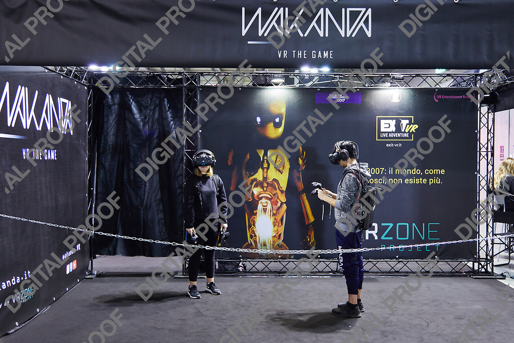 Milan, Italy - March 8 2019 Cartoomics Comic Con  visitors trying Virtual Reality Technology