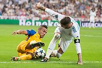 Real Madrid's Sergio Ramos and Apoel's Lorenzo Ebecillo during UEFA Champions League match between Real Madrid and Apoel at Santiago Bernabeu Stadium in Madrid, Spain September 13, 2017. (ALTERPHOTOS/Borja B.Hojas)