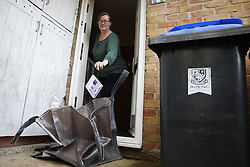 © Licensed to London News Pictures. 02/02/2021. Woking, UK. Residents return completed Covid-19 tests in Goldsworth Park in Woking, Surrey where cases of the South African variant of Covid-19 have been found. Public health England are carring out surge testing for selected parts of the Goldsworth Park, St Johns and Knaphill areas of Woking this week. Photo credit: Peter Macdiarmid/LNP